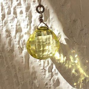 Yellow gemstone necklace.